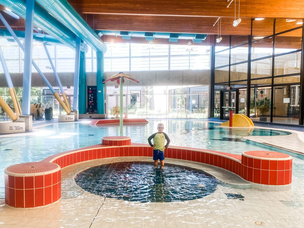 Sungod Recreation Centre in Delta has one of the best swimming pools for kids near Vancouver, BC.  Here a boy plays in the family pool.