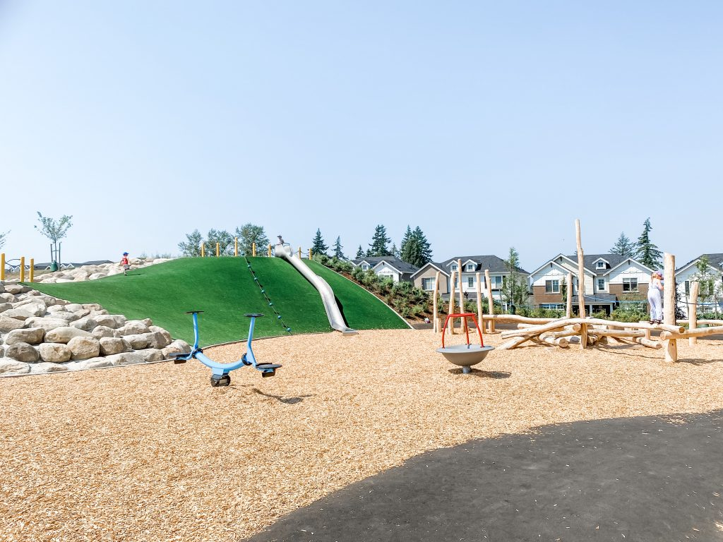 Edgewood Park is one of the best playgrounds in South Surrey. Pictured are the hillside slide, stand-up teeter totter, natural wood climbing structure and boulders for climbing.